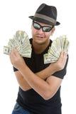 Hombre con las porciones de 100 notas del dólar Foto de archivo libre de regalías