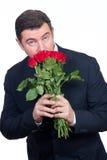 Hombre con las rosas imagen de archivo
