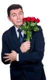 Hombre con las rosas fotografía de archivo libre de regalías