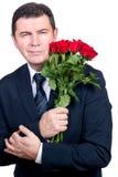 Hombre con las rosas imágenes de archivo libres de regalías