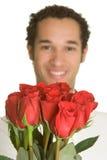 Hombre con las rosas Foto de archivo
