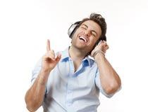 Hombre con los auriculares Imagenes de archivo
