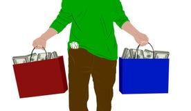 Hombre con los bolsos del dinero Fotografía de archivo libre de regalías