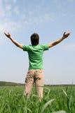 Hombre con los brazos Outstretched Foto de archivo libre de regalías