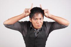 Hombre con los claxones del diablo Foto de archivo libre de regalías