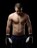 Hombre con los guantes de boxeo Imagen de archivo