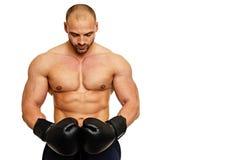 Hombre con los guantes del boxeador Imágenes de archivo libres de regalías