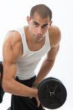 Hombre con los músculos foto de archivo