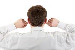 Hombre con los oídos cerrados Imágenes de archivo libres de regalías