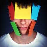 Hombre con los papeles en la cara Fotos de archivo libres de regalías