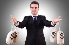 Hombre con los sacos del dinero Imágenes de archivo libres de regalías