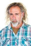 Hombre con mirada fija en blanco Fotografía de archivo