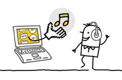 Hombre con música que escucha de la computadora portátil Foto de archivo libre de regalías