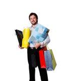 Hombre con muchos bolsos de compras fotografía de archivo