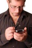 Hombre con PDA Fotografía de archivo libre de regalías