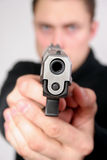 Hombre con un arma Imagenes de archivo