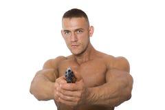 Hombre con un arma en un fondo blanco Imágenes de archivo libres de regalías