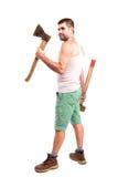 Hombre con un hacha y un martillo Foto de archivo