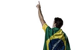 Hombre con una bandera brasileña en el suyo detrás Imágenes de archivo libres de regalías
