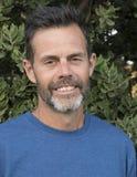 Hombre con una barba Imágenes de archivo libres de regalías