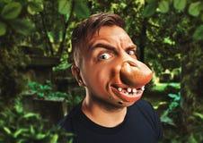 Hombre con una cara fea Foto de archivo libre de regalías