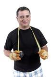 Hombre con una cinta métrica alrededor del cuello Foto de archivo