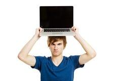 Hombre con una computadora portátil Foto de archivo