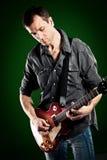 Hombre con una guitarra Imagen de archivo