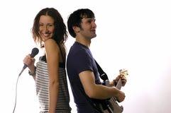 hombre con una guitarra y una mujer Fotografía de archivo libre de regalías
