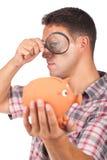 Hombre con una lupa Imagen de archivo libre de regalías