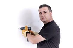 Hombre con una máquina del taladro Foto de archivo libre de regalías
