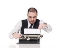 Hombre con una máquina de escribir Fotografía de archivo