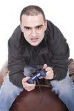 Hombre con una palanca de mando para la consola del juego Fotografía de archivo libre de regalías