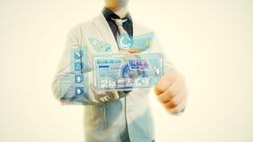 Hombre con una pantalla futurista Imagenes de archivo