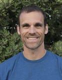 Hombre con una sonrisa Foto de archivo libre de regalías