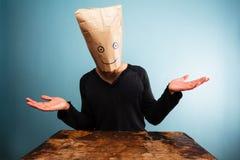 Hombre confuso con el bolso de arriba Fotos de archivo libres de regalías
