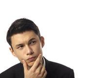 Hombre corporativo asiático joven que reflexiona Imagenes de archivo