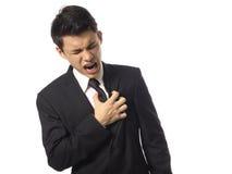Hombre corporativo asiático que tiene una quemadura de corazón Imagen de archivo libre de regalías