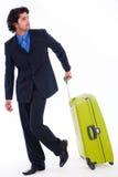 Hombre corporativo que mira detrás con el equipaje Imagen de archivo