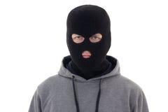 Hombre criminal en la máscara negra aislada en blanco Fotos de archivo