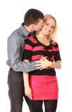 Hombre cuidadoso que besa a su novia sonriente Imágenes de archivo libres de regalías