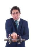 Hombre débil en el traje que levanta un peso Imagen de archivo libre de regalías