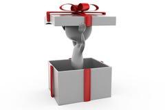 hombre 3d en concepto de la caja de regalo Fotos de archivo