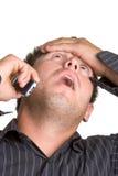 Hombre dado una sacudida eléctrica del teléfono Imagenes de archivo