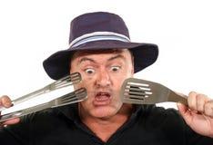 Hombre dado una sacudida eléctrica en sombrero Imágenes de archivo libres de regalías