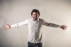 Hombre de griterío con los brazos abiertos Imagen de archivo