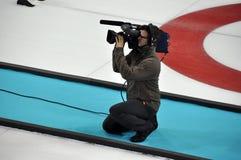 Hombre de la cámara en XXII los juegos de olimpiada de invierno Sochi 2014 Fotos de archivo libres de regalías