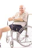Hombre de la desventaja en sillón de ruedas Fotos de archivo libres de regalías
