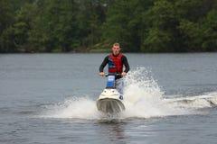 Hombre de la foto de la acción en el esquí del jet Imagen de archivo libre de regalías