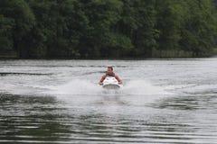 Hombre de la foto de la acción en el Watercraft de Seadoo Imágenes de archivo libres de regalías